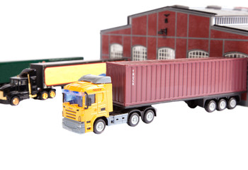 Unloading big container trucks at warehouse building