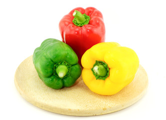 sweet pepper and  chopping block on white background