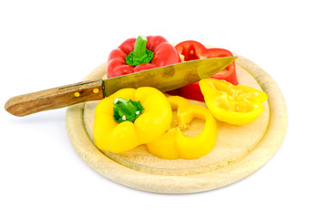 yellow sweet pepper slice and chopping block on white background