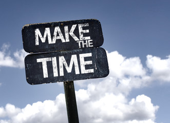 Make The Time sign with clouds and sky background
