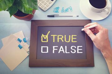 True or False checkboxes sketched on a little blackboard
