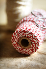 Spool of red and white twine