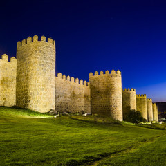 Scenic medieval city walls of Avila at night, Spain, UNESCO list
