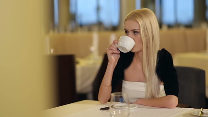 Young Attractive Woman Drinking Coffee In Restaurant 3