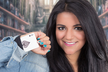 Pretty young brunette woman posing with deck of cards