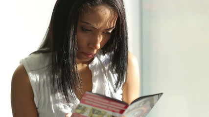 Woman Read a Magazine Near Window