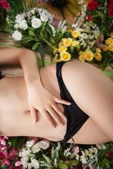 Slim body of female with flowers