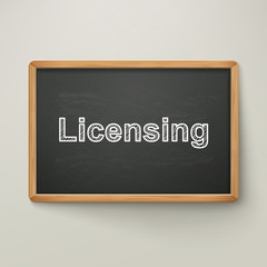 licensing on blackboard in wooden frame
