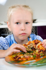 Starving young girl eating