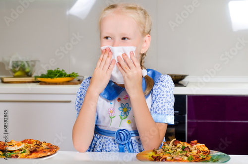 canvas print picture Young girl wiping her mouth