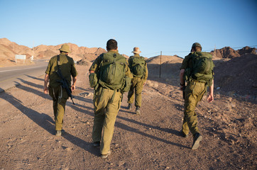 Soldiers patrol in desert