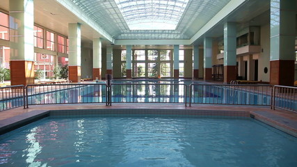 Empty magnificent swimming pool indoor