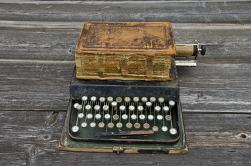 antique typewriter with  old used book Bible