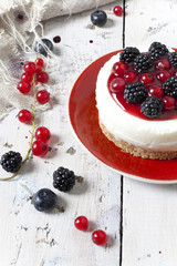 mini cheesecake with blackberries blueberries and red currant