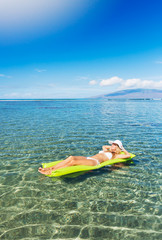 Woman relaxing and floating in the ocean