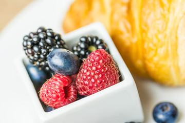 Croissant And Fresh Fruits Breakfast
