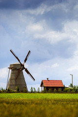 Silhouette of a farm , house and windmill.