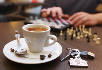 Cup of coffee and chess
