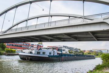 Cargo ship passing under the bridge