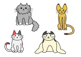 座っている猫たち