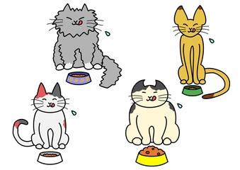 食べている猫たち