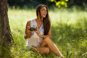 Attractive female relaxing in nature.Taking photo.