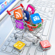 Store of laptop software. Apps icons in shopping cart.