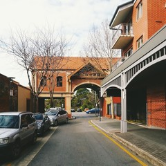 Urban street view with red brick arch