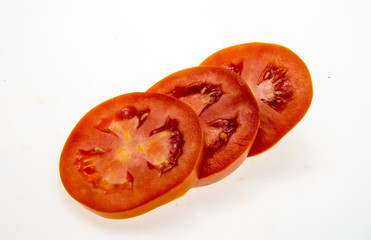 tomato slices over a white background