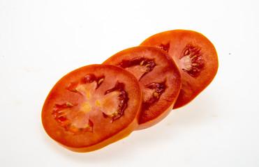 tomato slices over a white background