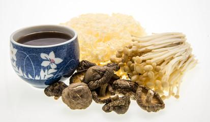 mushroom tea and assortment of mushrooms