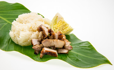 Barbecued pork and sticky rice on leafs