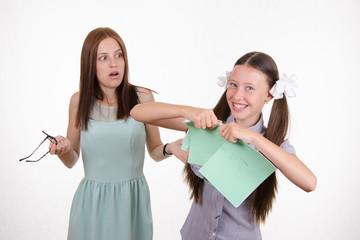 Schoolgirl got a bad grade and tear notebook