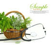 Fresh herbs in a basket and stethoscope on white background