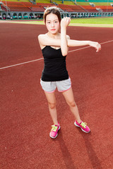Asian athlete stretching before jogging