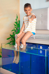 child on Fish spa feet pedicure skin care treatment,with the fis