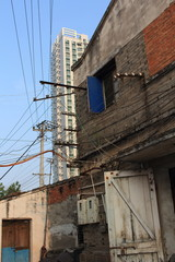 The old building and new building,the rambling electric wires