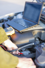Mechanic measuring engine electricity meter