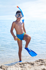 Summer vacation - Portrait of happy boy in face masks and snorke