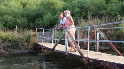 Couple talks on the bridge