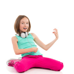 Little girl playing the air guitar and singing.