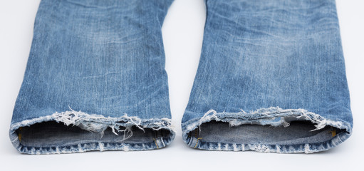 Closeup of tear in old jeans