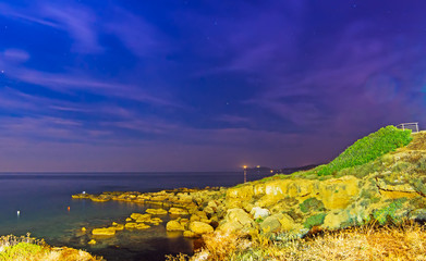 rocky shore by night