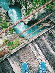wooden bridge over the bed of soca river