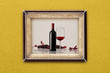 bottle and glass of wine in the frame on the wall - 68607043