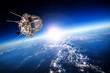 Space satellite over the planet earth - 68607239