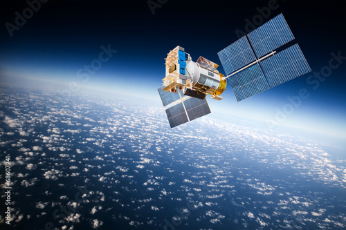 Foto op Canvas Ruimtelijk Space satellite over the planet earth