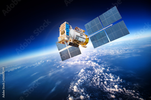 Leinwanddruck Bild Space satellite over the planet earth