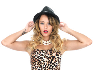 Young Woman Wearing Leopard Print Top and Hat