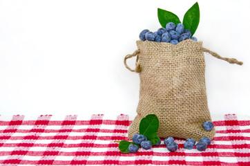 blueberries in burlap bag